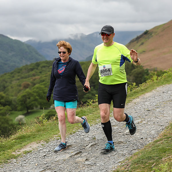 Runners enjoying trails in the hills