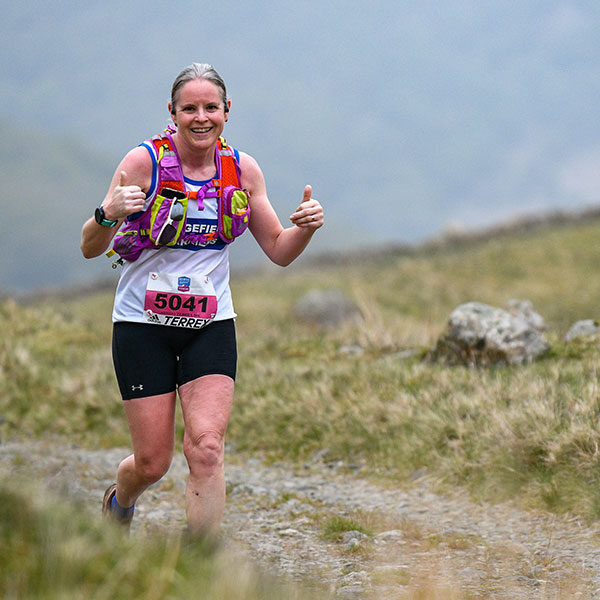 Two thumbs up from trail runner on course