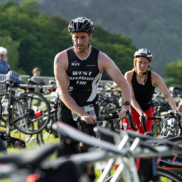 Male and Female Triathletes at transition