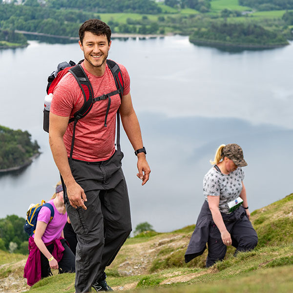 Male competitor enjoying Three Peaks Hike